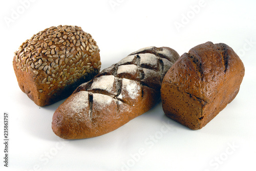 loaf of bread with sunflower seeds isolated on white