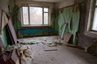 Room in 9-storey apartment building in dead abandoned ghost town Pripyat, Chernobyl NPP Exclusion Zone, Ukraine