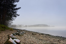 Lakeside Shore And Islands Hidden Behind Thick Fog