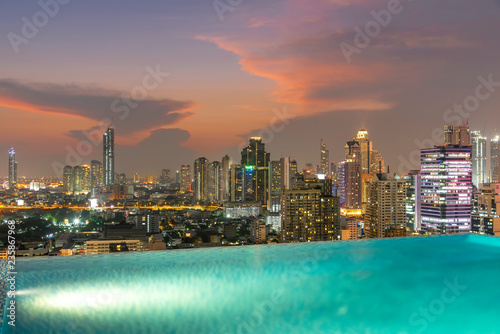 Fotobehang Stad gebouw Bangkok city at sunset with swimming pool in foreground. Traveling to Thailand.