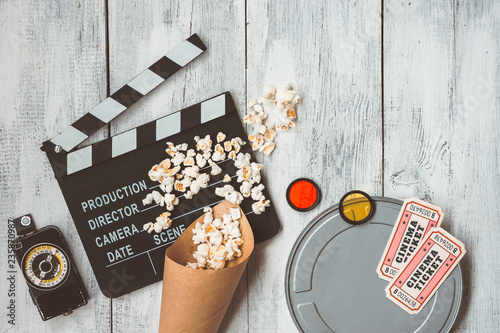 Clapperboard, movie box, popcorn bag and movie tickets