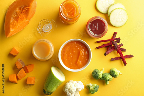 Valokuva  Flat lay composition with healthy baby food on color background