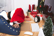 business woman with santa hat sleeping on desk office after christmas party and happy new year.