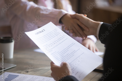 Fototapety, obrazy: Business partners handshaking signing contract. Deal with good result, start of work with business partner or customer, agreement conclusion, client enters into a contract, human resource. Close up