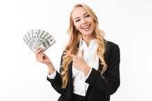 Portrait Of Young Woman Wearing Office Clothing Holding Fan Of Money, Isolated Over White Background