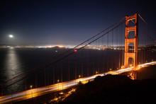 Cars Driving Across Golden Gate Bridge At Night, San Francisco, California, United States