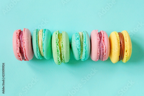 Sweet Almond Colorful Pink Blue Yellow Green Macaron Or Macaroon Dessert Cake Isolated On Trendy Blue Pastel Background French Sweet Cookie Minimal Food Bakery Concept Flat Lay Top View Copy Space