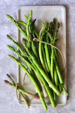 Bunch Of Fresh Green Asparagus Spears Loosely Tied With String.