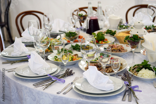 Wedding tables with food for the Banquet. Interior in soft colors for guests at the party.