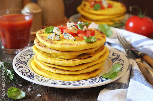 Oriental cuisine. Salty flat cakes with blue cheese and tomatoes
