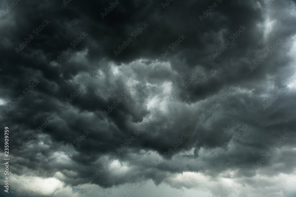 Fototapeta Dramatic black clouds before rainy, Motion heavy storm and dark sky in summe, Bad weather with black cumulonimbus clouds movement