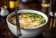 Pho Bo - Vietnamese Fresh Rice Noodle Soup With Chicken, Herbs And Chili. Vietnam's National Dish.