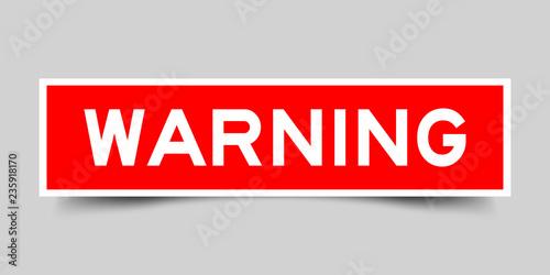 Obraz Square red sticker label in word warning on gray background - fototapety do salonu
