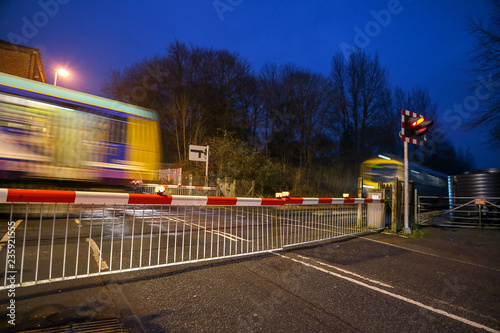 Barriers down at the level crossing Canvas-taulu