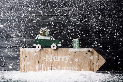 Valokuva  text merry christmas in a wooden signboard