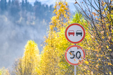 View Of Two Road Signs In Autumn Mountains
