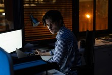 Male Executive Working At Desk