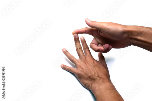 Obraz na plátne  the finger of right hand provoking the nail of left hand on white background iso