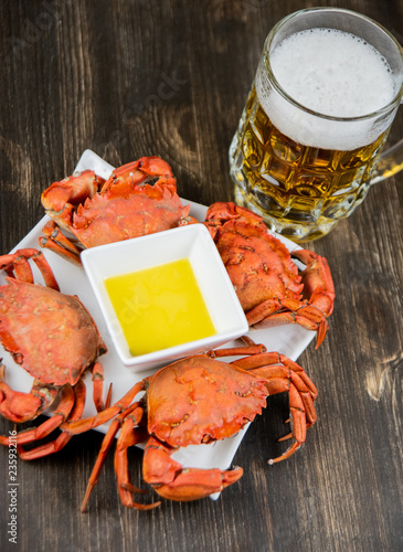 Crabs with butter sauce and a mug of beer