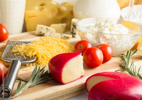 Cheeses, Cherry Tomatoes and Milk on the Wooden Platter - Close