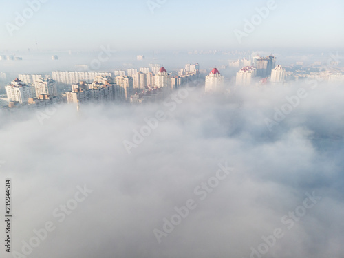 Aerial view of city covered with thick fog, Kyiv, Ukraine
