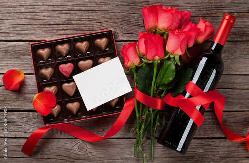Red roses, wine bottle and chocolate box