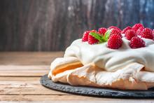 Homemade Cake Pavlova With Whipped Cream And Fresh Raspberry.