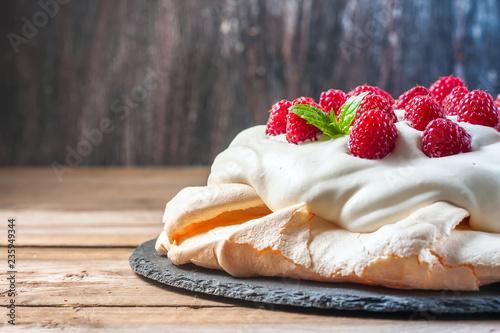 Obraz na plátne Homemade cake Pavlova with whipped cream and fresh raspberry.
