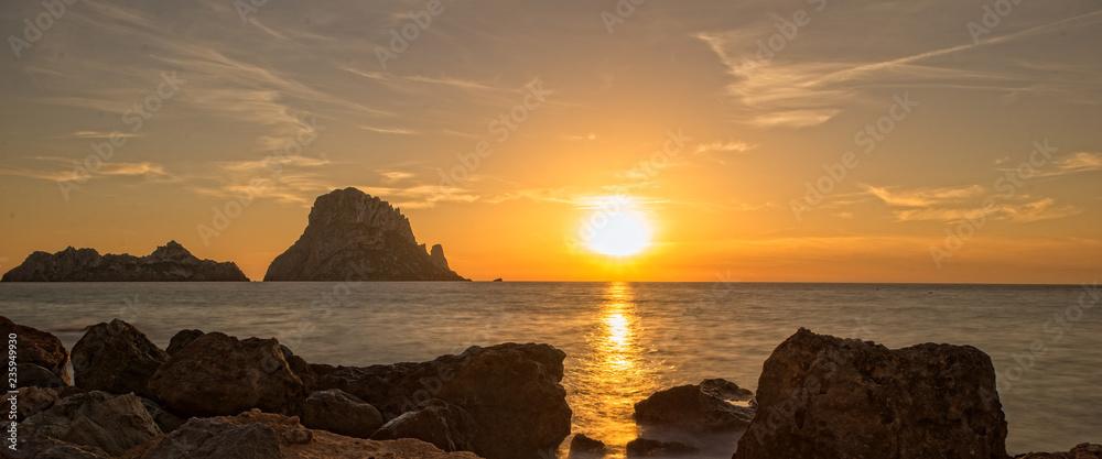 Fototapeta Panoramic of the island of Es Vedra at sunset, Ibiza