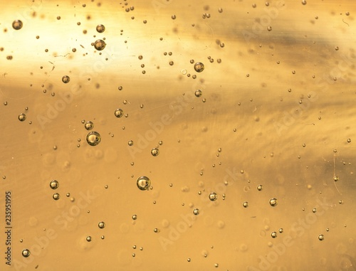 Tablou Canvas Close up of carbonation bubbles in champagne
