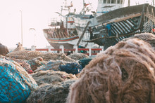 Fishing Boat Anchored With A Pile Of Fishnet