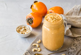 Smoothie with persimmon and cashew nuts