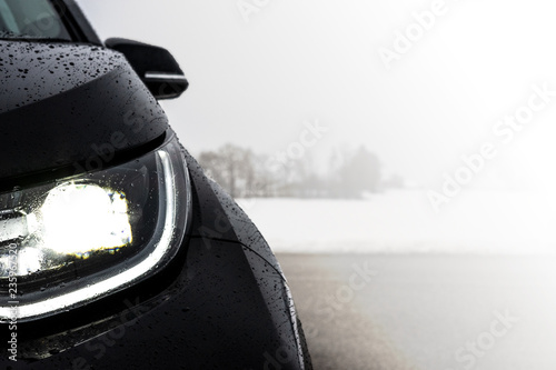 Foto op Canvas Licht, schaduw Modern black car headlight