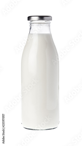 Filled unopened milk bottle isolated on white background