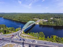 Aerial View Of Merrimack River And Tyngsboro Bridge In Downtown Tyngsborough, Massachusetts, USA.