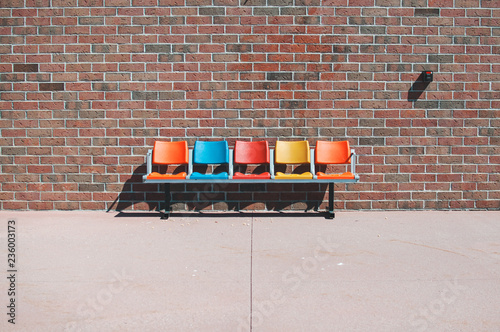 Empty chairs against brick wall - 236003173