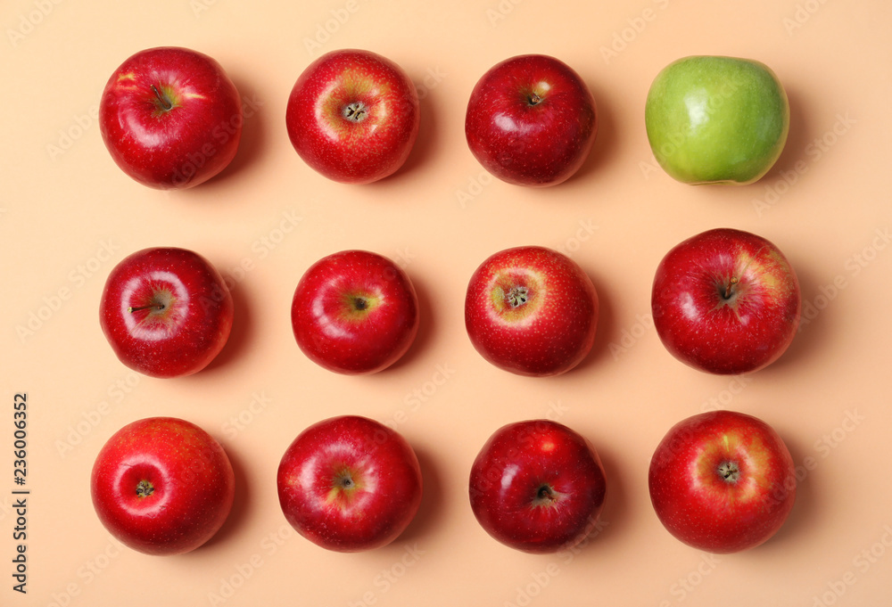 Fototapety, obrazy: Green apple among red ones on color background, top view. Be different
