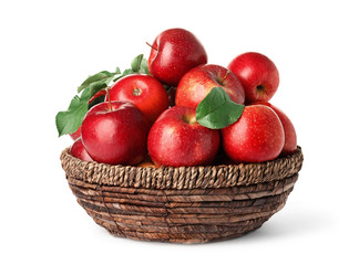 Juicy red apples in wicker basket on white background