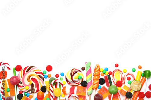 Many different yummy candies on white background, top view. Space for text