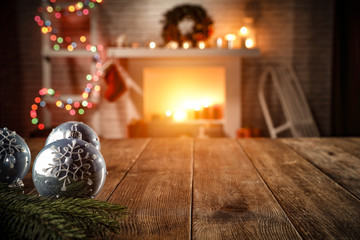 Obraz na Plexiwooden table with attributes of Christmas in the glow of the fireplace