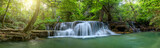 Panoramic beautiful deep forest waterfall