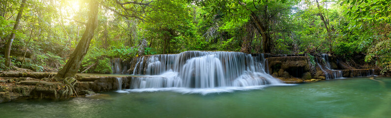 Panoramic beautiful deep forest waterfall