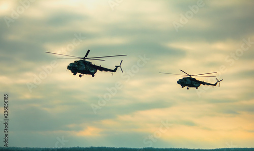Helicopter in flight at sunset in summer