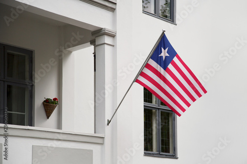 Liberia flag hanging on a pole in front of the house