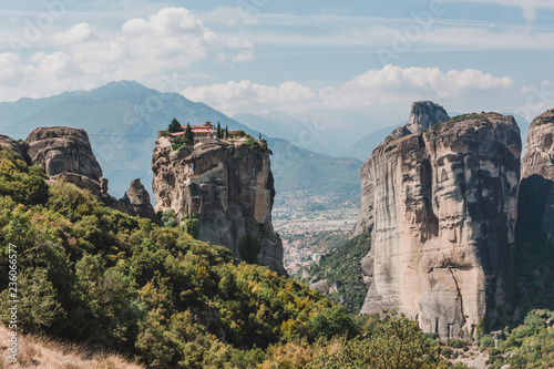 Staande foto Bleke violet Mountain scenery with Meteora rocks and Roussanou Monastery, landscape place of monasteries on the rock.