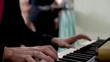 Keyboard player playing at wedding ceremony. Panoramic plane shift