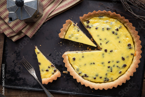 Delicious homemade tart with ricotta cheese and chocolate filling on dark vintage baking tray Canvas Print