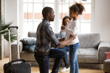 Unhappy African American Father Saying Goodbye To Sad Preschooler Daughter, Kneeling, Explaining Why Should Go, Child Stay With Mother, Dad Leave With Suitcase, Parents Divorce, Break Up Concept