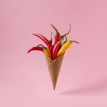 Hot Chili Pepper In Ice Cream Cone On Pink Background. Minimal Food Concept.