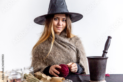 Fototapeta A young woman wearing a witch costume